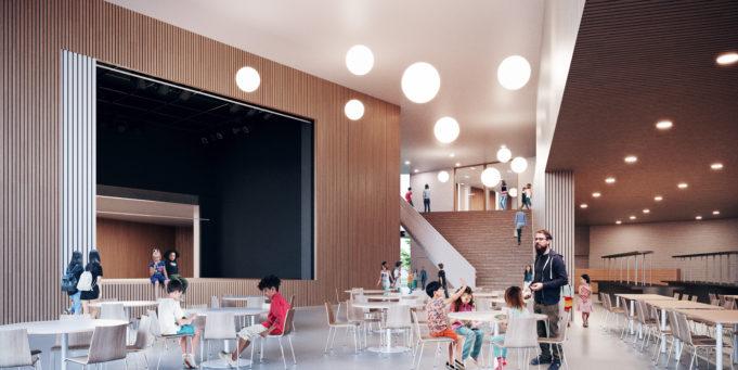 Havainnekuva Lamminrahkan yhtenäiskoulun sydänaulasta. Kuvassa on lapsia ja mieshenkilö. Aulassa näkyy esiintymislava, pöytäryhmiä ja portaikko.